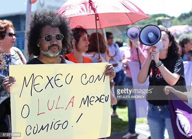 Supporters of Brazil's former president Luiz Inacio Lula da Silva gather in front of the Federal Police headquarters in Curitiba Brazil on March 04...