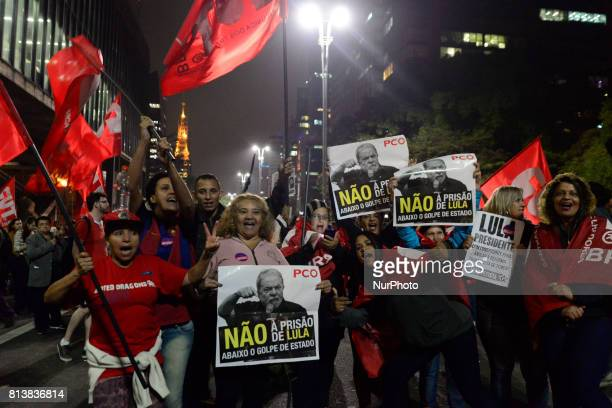Supporters of Brazil's former president Luiz Inacio Lula da Silva take part in a demo in Sao Paulo Brazil July 12 after he was sentenced to nearly 10...