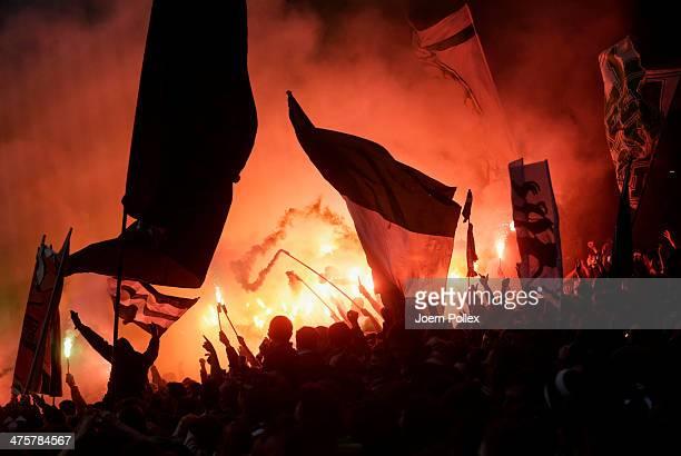 Supporters of Bremen burn pyrotechnics during the Bundesliga match between Werder Bremen and Hamburger SV at Weserstadion on March 1 2014 in Bremen...