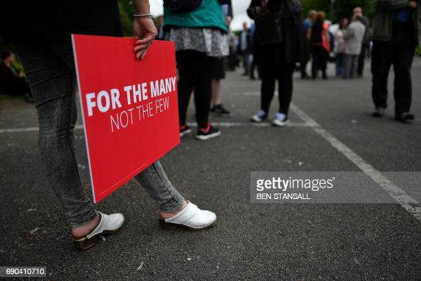 Supporters of Britain's main opposition Labour party await the arrival of th party's leader Jeremy Corbyn at a general election campaign event in...