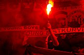Supporters of BSC Young Boys light flares during the UEFA Europa League Group I football match SK Slovan Bratislava vs BSC Young Boys in Bratislava...