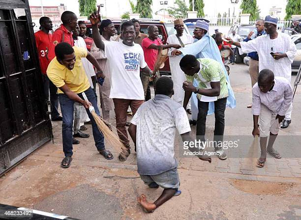 Supporters of Buhari celebrate the election result after The Independent National Election Commission announced late Monday that Buhari won the...