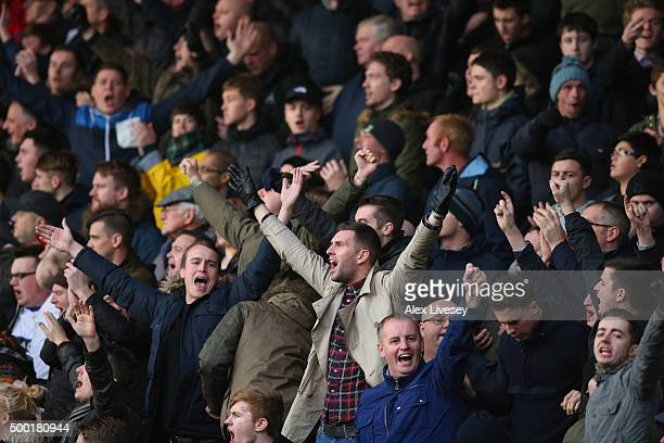 Supporters of Bury celebrate during The Emirates FA Cup Second Round match between Rochdale and Bury at Spotland on December 6 2015 in Rochdale...