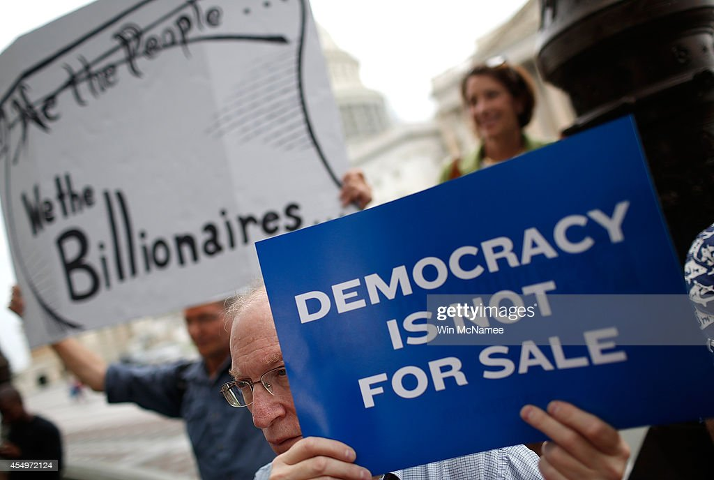 Supporters of campaign finance reform listen as members of Congress discuss a joint resolution proposing an amendment to the Constitution of the...