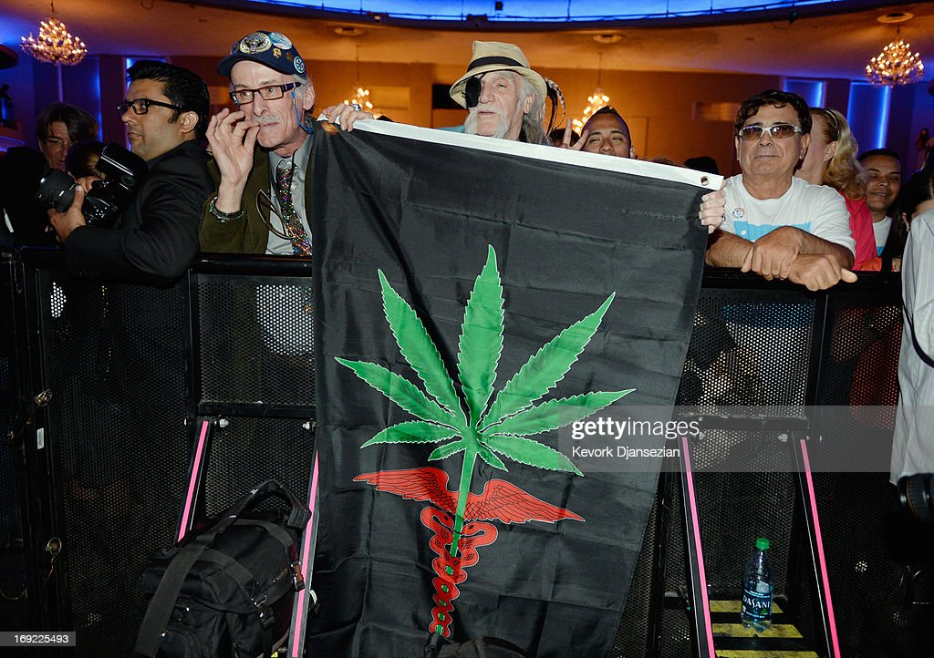 Supporters of candidate in the Los Angeles City mayoral race, Councilman Eric Garcetti hold up a medicinal marjuana flag during the election night party at The Hollywood Palladium on May 21, 2013 in the Silver Lake area of Los Angeles, California. Early results suggest that Garcetti is leading against Los Angeles City Controller Wendy Greuel for the seat held by two-term Antonio Villaraigosa.