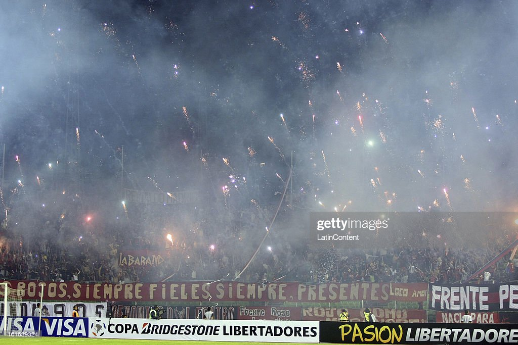 Supporters of Caracas FC launch fireworks before a game between Fluminense FC and Caracas as part of the Copa Bridgestone Libertadores 2013 at the Olympic Stadium on February 13, 2013 in Caracas, Venezuela.