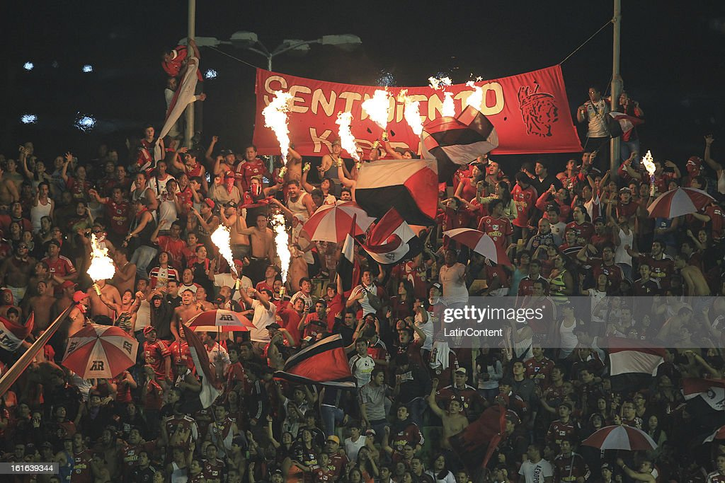 Supporters of Caracas FC support their team during a game between Fluminense FC and Caracas as part of the Copa Bridgestone Libertadores 2013 at the Olympic Stadium on February 13, 2013 in Caracas, Venezuela.