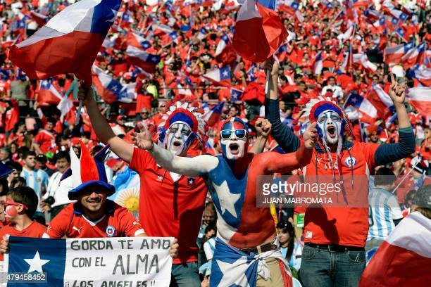 Supporters of Chile cheer for their team before the start of the 2015 Copa America football championship final Argentina vs Chile in Santiago Chile...