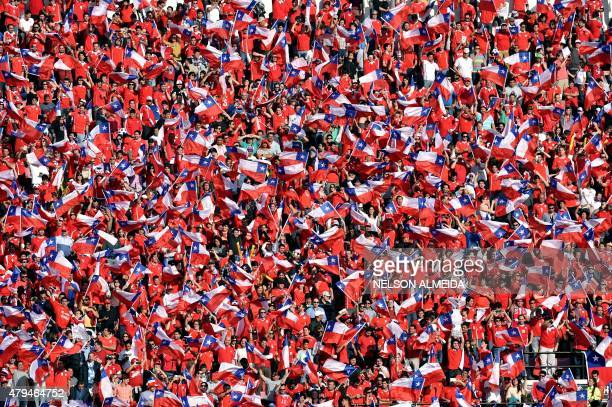 Supporters of Chile cheer for their team before the start of the 2015 Copa America final football match against Argentina in Santiago Chile on July 4...