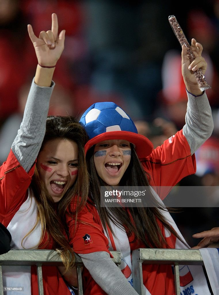 Supporters of Chile cheer for their team before the start of the Brazil 2014 FIFA World Cup South American qualifier match against Venezuela, in Santiago, on September 6, 2013.