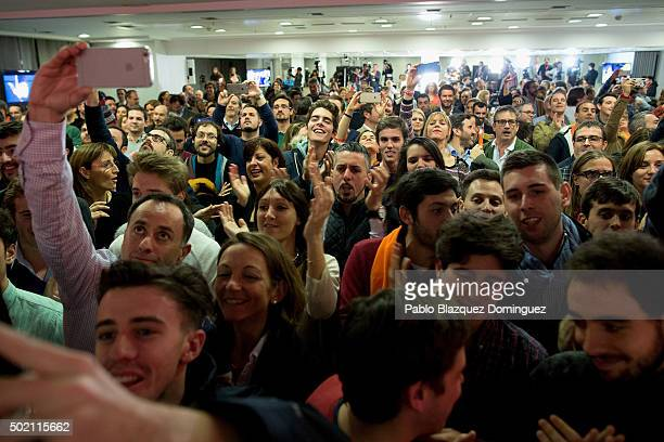 Supporters of Ciudadanos party cheer as his leader Albert Rivera speaks about the final general elections results at Hotel Eurobuilding on December...