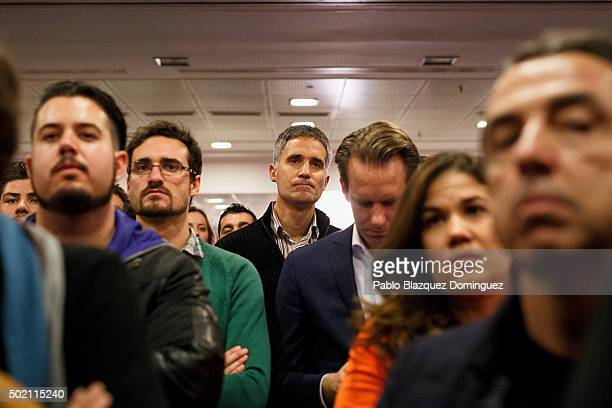 Supporters of Ciudadanos party watch their leader Albert Rivera speaking about the final general elections results at Hotel Eurobuilding on December...