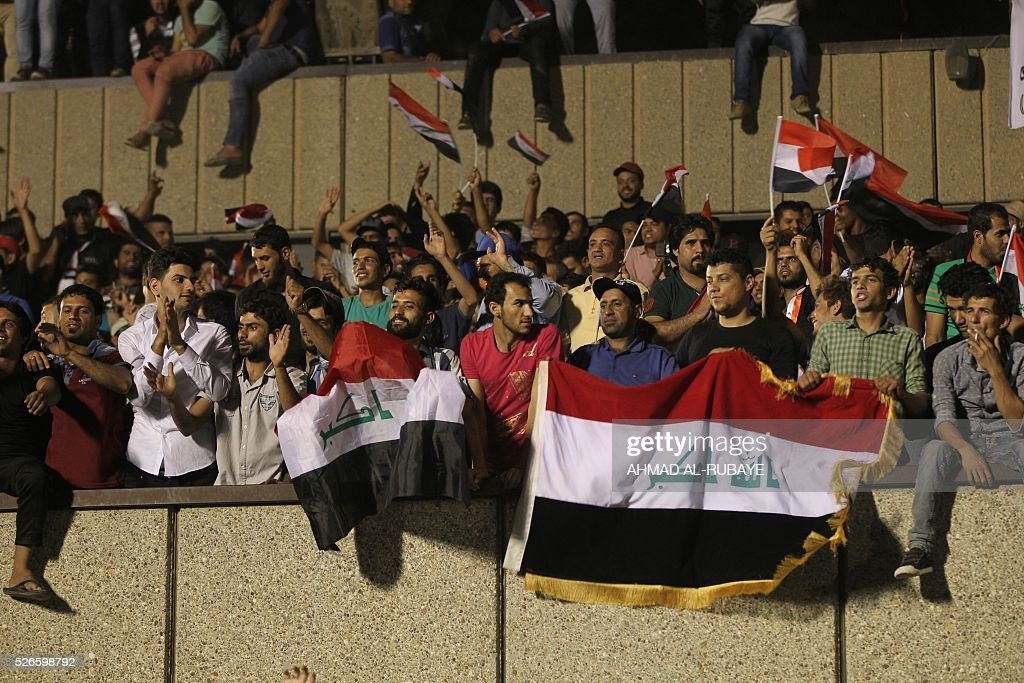 Supporters of cleric Moqtada al-Sadr gather in the courtyard of celebrations after breaking into Baghdad's heavily fortified 'Green Zone' on April 30, 2016. Thousands of angry protesters broke into Baghdad's Green Zone and stormed the parliament building after lawmakers again failed to approve new ministers. Jubilant supporters of cleric Moqtada al-Sadr invaded the main session hall, shouting slogans glorifying their leader and claiming that they had rooted out corruption. / AFP / AHMAD