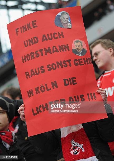 Supporters of Cologne present a banner demanding to dismiss manager Volker Finke and CEO Claus Horstmann during the Bundesliga match between 1 FC...
