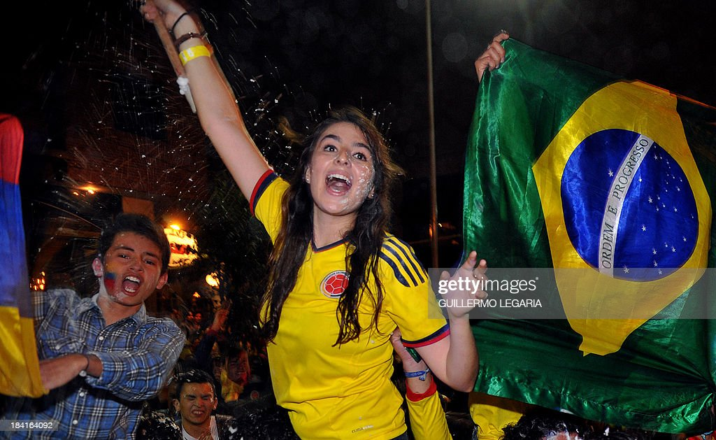 Supporters of Colombia celebrate in Bogota, after qualifying for the Brazil 2014 FIFA World Cup after a 3-3 tie with Chile in a South American qualifier match in Barranquilla, on October 11, 2013. AFP PHOTO/Guillermo Legaria