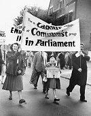 Supporters of Communist candidate J R Campbell marching through Woodford in Essex in the runup to the General Election 20th October 1951 Campbell is...