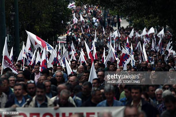 Supporters of Communistaffiliated trade union PAME take part in a demonstration against the reform package in Athens on May 22 2016 Greece on May 22...