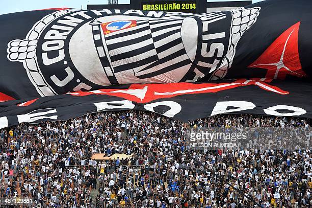 Supporters of Corinthians cheer their team during their Brazilian championship football match against Flamengo at Pacaembu stadium in Sao Paulo...