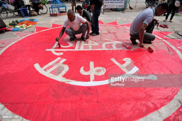 Supporters of CPNUML decorating the streets of Katmandu for welcoming new mayor of the Kathmandu Metropolitan City Bidya Sundar Shakya on Sunday May...