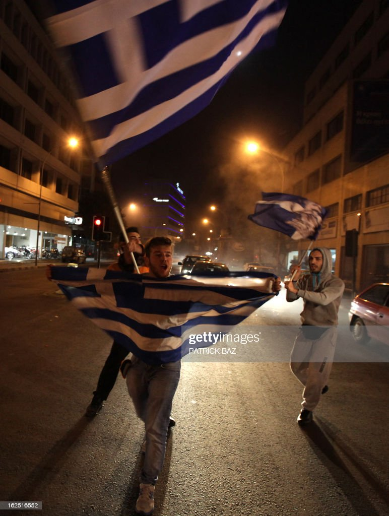 Supporters of Cypriot right-wing leader Nicos Anastasiades holding Greek flags celebrate that he won the presidential election in Nicosia on February 24, 2013. Anastasiades won the presidential election in Cyprus, securing a mandate to negotiate a crucial bailout for the EU state on the brink of bankruptcy.