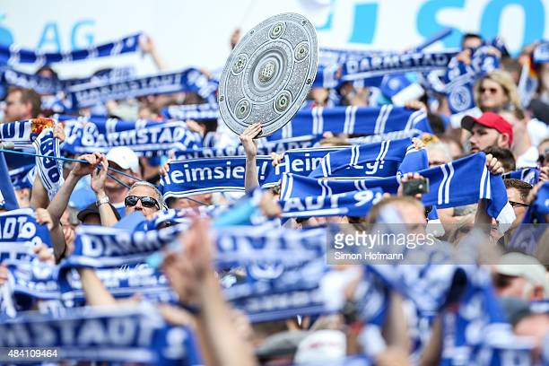 Supporters of Darmstadt are seen during the Bundesliga match between SV Darmstadt 98 and Hannover 96 at MerckStadion am Boellenfalltor on August 15...