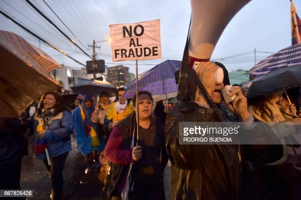Supporters of defeated Ecuadorean presidential candidate Guillermo Lasso during a rally in northern Quito on April 12 2017 Lasso challeged the result...