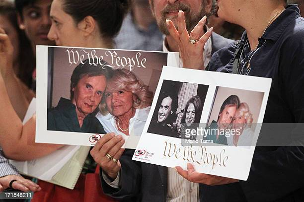 Supporters of Defense of Marriage Act plaintiff Edith 'Edie' Windsor wait for her to enter a press conference in Manhattan following the US Supreme...