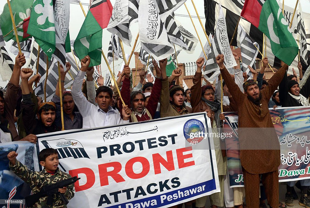Supporters of Defense of Pakistan Council (DPC), a coalition of religious and political parties, chant anti-US slogans during a protest against the US drone strikes in the Pakistani tribal region, in Peshawar on November 10, 2013. Pakistan reacted angrily to the drone attack that killed Tehreek-e-Taliban Pakistan (TTP) chief Hakimullah Mehsud in the North Waziristan tribal area. Islamabad condemns drone strikes as a violation of sovereignty, and Prime Minister Nawaz Sharif urged President Barack Obama to end them during White House talks.