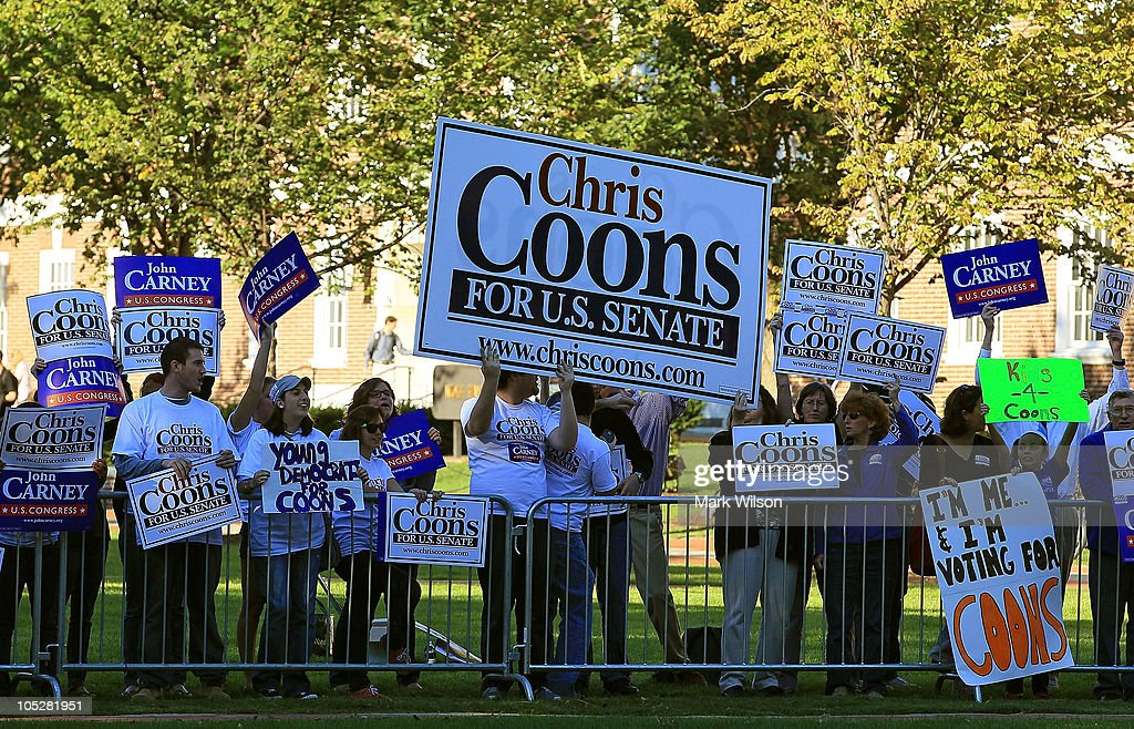 Supporters of Democratic hopeful Chris Coons hold campaign signs in front of the debate hall at the University of Delaware on October 13 2010 in...