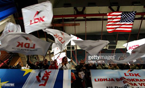 Supporters of Democratic League of Kosovo wave flags during an electoral rally in Pristina 27 October 2007 General elections are scheduled in Kosovo...