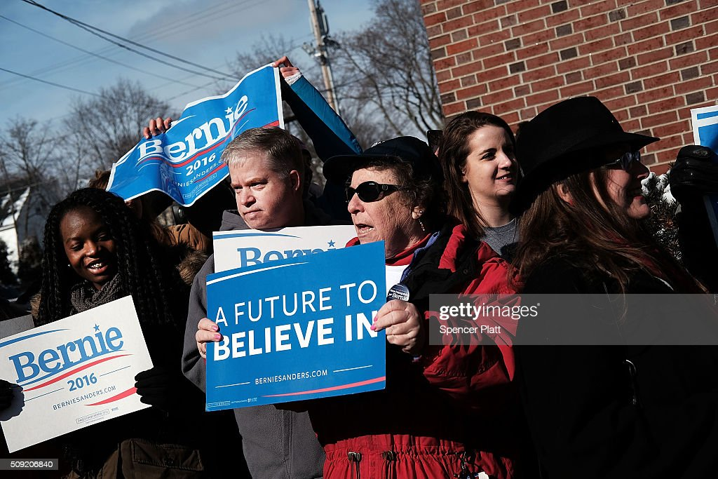 Supporters of Democratic presidential candidate Bernie Sanders wait for his arrival into downtown Concord on Primary Day on February 9, 2016 in Concord, New Hampshire. Sanders, who is expected to win over Democratic rival Hillary Clinton, greeted voters before taking a short walk where he was mobbed by members of the media.