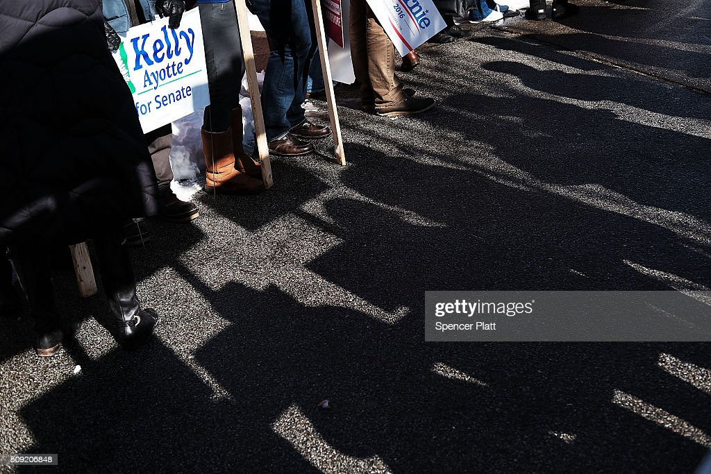 Supporters of Democratic presidential candidate Bernie Sanders wait for his arrival in downtown Concord on Primary Day on February 9, 2016 in Concord, New Hampshire. Sanders, who is expected to win over Democratic rival Hillary Clinton, greeted voters before taking a short walk where he was mobbed by members of the media.