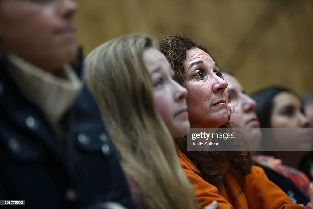 Supporters of Democratic presidential candidate former Secretary of State Hillary Clinton look on as she speaks during a get out the vote organizing event at Rundlett Middle School on February 6, 2016 in Concord, New Hampshire. With less than one week to go before the New Hampshire primaries, Hillary Clinton continues to campaign throughout the state.