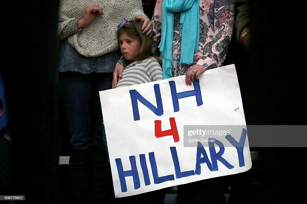 Supporters of Democratic presidential candidate former Secretary of State <a gi-track='captionPersonalityLinkClicked' href=/galleries/search?phrase=Hillary+Clinton&family=editorial&specificpeople=76480 ng-click='$event.stopPropagation()'>Hillary Clinton</a> look on as she speaks during a get out the vote organizing event at Rundlett Middle School on February 6, 2016 in Concord, New Hampshire. With less than one week to go before the New Hampshire primaries, <a gi-track='captionPersonalityLinkClicked' href=/galleries/search?phrase=Hillary+Clinton&family=editorial&specificpeople=76480 ng-click='$event.stopPropagation()'>Hillary Clinton</a> continues to campaign throughout the state.