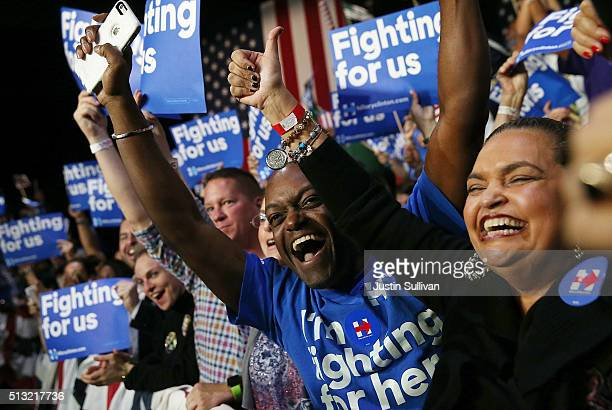 Supporters of democratic presidential candidate former Secretary of State Hillary Clinton cheer during her Super Tuesday evening gathering Stage One...