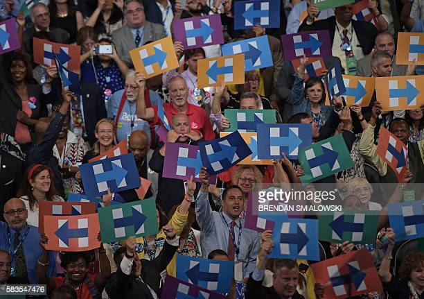 Supporters of Democratic presidential candidate Hillary Clinton hoist signs with their candidate's logo during the roll call on Day 2 of the...
