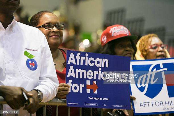 Supporters of Democratic presidential candidate Hillary Clinton hold signs during an ''African Americans For Hillary'' rally at Clark Atlanta...