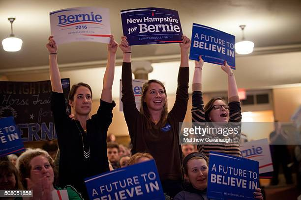 Supporters of Democratic presidential candidate Sen Bernie Sanders cheer as Sanders speaks at the Claremont Opera House on February 2 2016 in...
