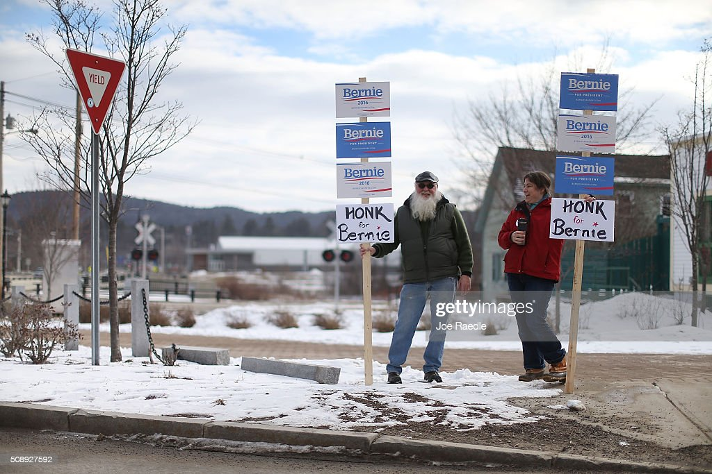 Supporters of Democratic presidential candidate Sen. Bernie Sanders (I-VT), Steven Woodbury (L) and Kristen Walsh show their support for him on February 7, 2016 in Plymouth, New Hampshire. Democratic and Republican presidential candidates are stumping for votes throughout New Hampshire leading up to the Presidential primary on February 9.