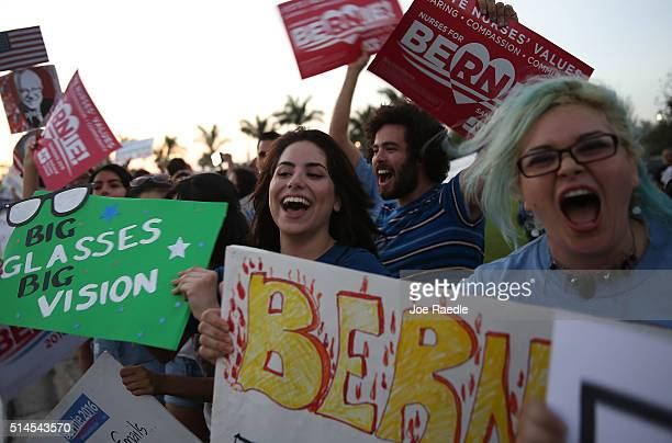 Supporters of Democratic presidential candidate Senator Bernie Sanders show their support for him before his debate against Democratic presidential...
