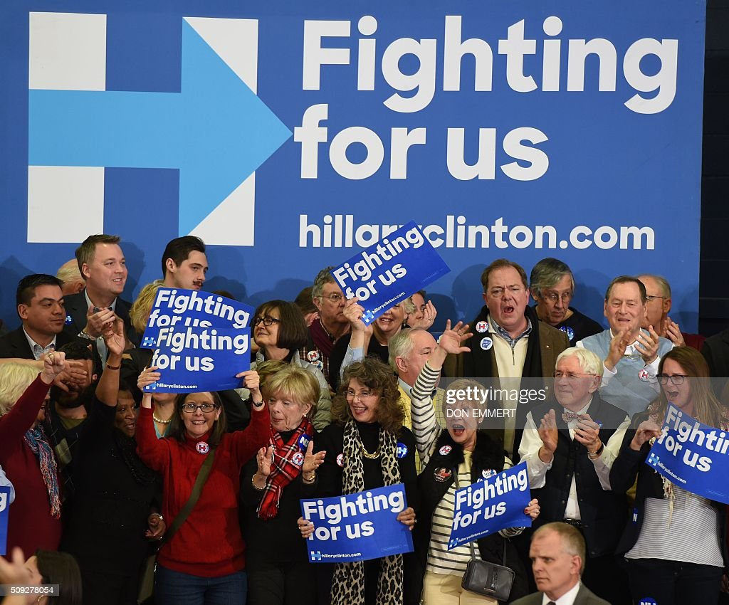 Supporters of Democratic presidential hopeful Hillary Clinton cheer during her primary night party February 9, 2016 at Southern New Hampshire University in Hooksett, New Hampshire. Clinton, who suffered a deflating if expected defeat to Bernie Sanders, put a brave face on the loss and admitted she had some work to do as the campaign moves south. / AFP / Don EMMERT