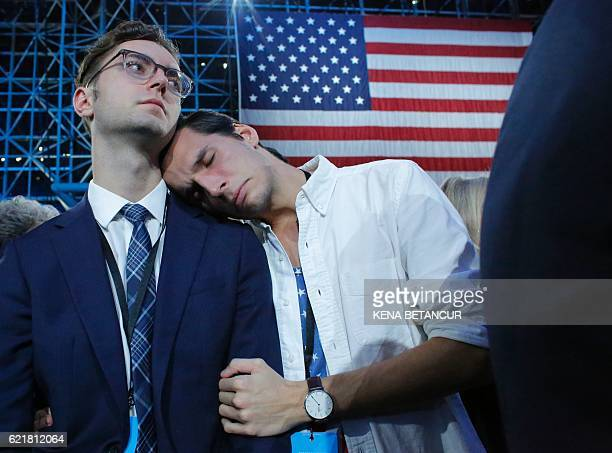 TOPSHOT Supporters of Democratic presidential nominee Hillary Clinton react during election night at the Jacob K Javits Convention Center in New York...