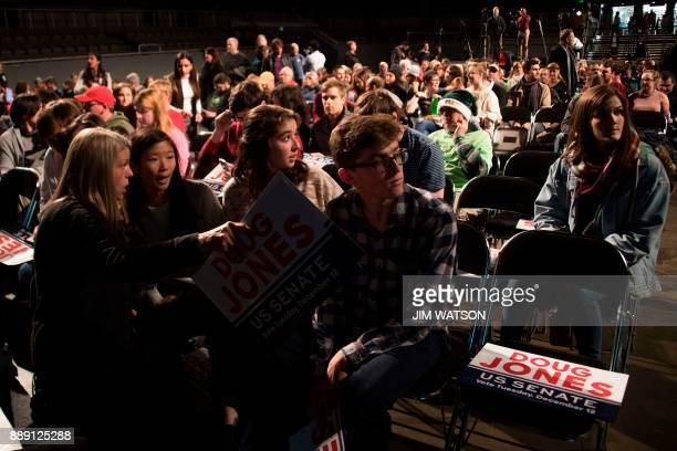 Supporters of Democratic Senatorial candidate Doug Jones arrive for a rally in Birmingham Alabama on December 9 2017 The Alabama race which is being...