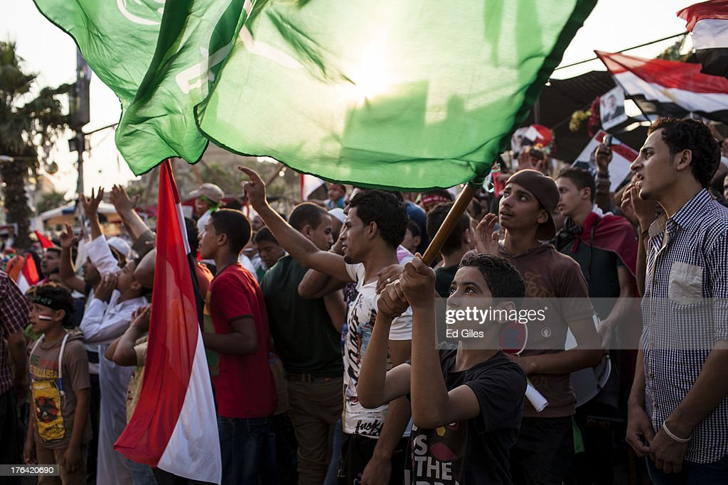 Supporters of deposed Egyptian President Mohammed Morsi attend a sit-in demonstration at Nahda Square in the Giza district on August 12, 2013 in Cairo, Egypt. Egyptian security forces threatened to begin a siege of pro-Morsi protest camps in Cairo overnight on August 11, however Egypt's Interior Ministry appeared to have put off plans to crack down on protesters early on August 12. On Monday Egypt's judiciary also extended deposed President Morsi's detention for a further 15 days pending investigation into charges of his collaboration with the Palestinian Hamas movement. Morsi supporters have continued to protest at sites across Cairo over one month after the Egyptian military deposed Egypt's first democratically elected President, Mohammed Morsi, on July 3. (Photo by Ed Giles/Getty Images).