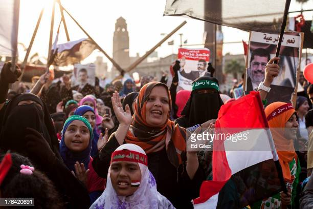Supporters of deposed Egyptian President Mohammed Morsi attend a sitin demonstration at Nahda Square in the Giza district on August 12 2013 in Cairo...