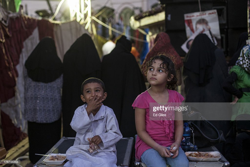 Supporters of deposed Egyptian President Mohammed Morsi break their fast during the 'Iftar' meal at a sitin protest at the Rabaa al Adweya Mosque on...