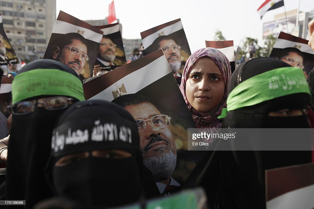 Supporters of deposed Egyptian President Mohammed Morsi demonstrate at the Rabaa alAdweya Mosque in the Nasr City district on July 8 2013 in Cairo...