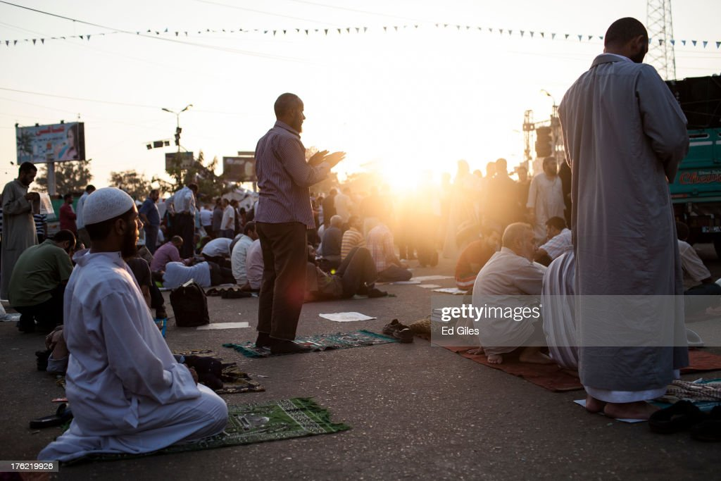 Supporters of deposed Egyptian President Mohammed Morsi perform morning prayer at sunrise during a sit-in demonstration near the Rabaa al-Adweya Mosque in the Nasr City district on August 12, 2013 in Cairo, Egypt. Egyptian security forces threatened to begin a siege of pro-Morsi protest camps in Cairo overnight on August 11, however Egypt's Interior Ministry appeared to have put off plans to crack down on protesters early on Monday. Morsi supporters have continued to protest at sites across Cairo over one month after the Egyptian military deposed Egypt's first democratically elected President, Mohammed Morsi, on July 3. (Photo by Ed Giles/Getty Images).