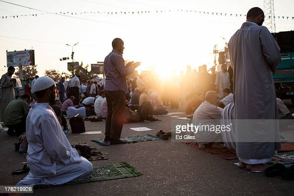 Supporters of deposed Egyptian President Mohammed Morsi perform morning prayer at sunrise during a sitin demonstration near the Rabaa alAdweya Mosque...