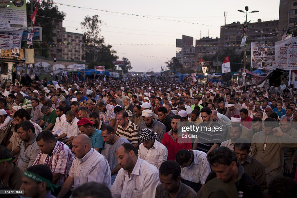 Supporters of deposed Egyptian President Mohammed Morsi pray prior to the 'iftar' fastbreaking meal at a sitin protest at the Rabaa al Adweya Mosque...